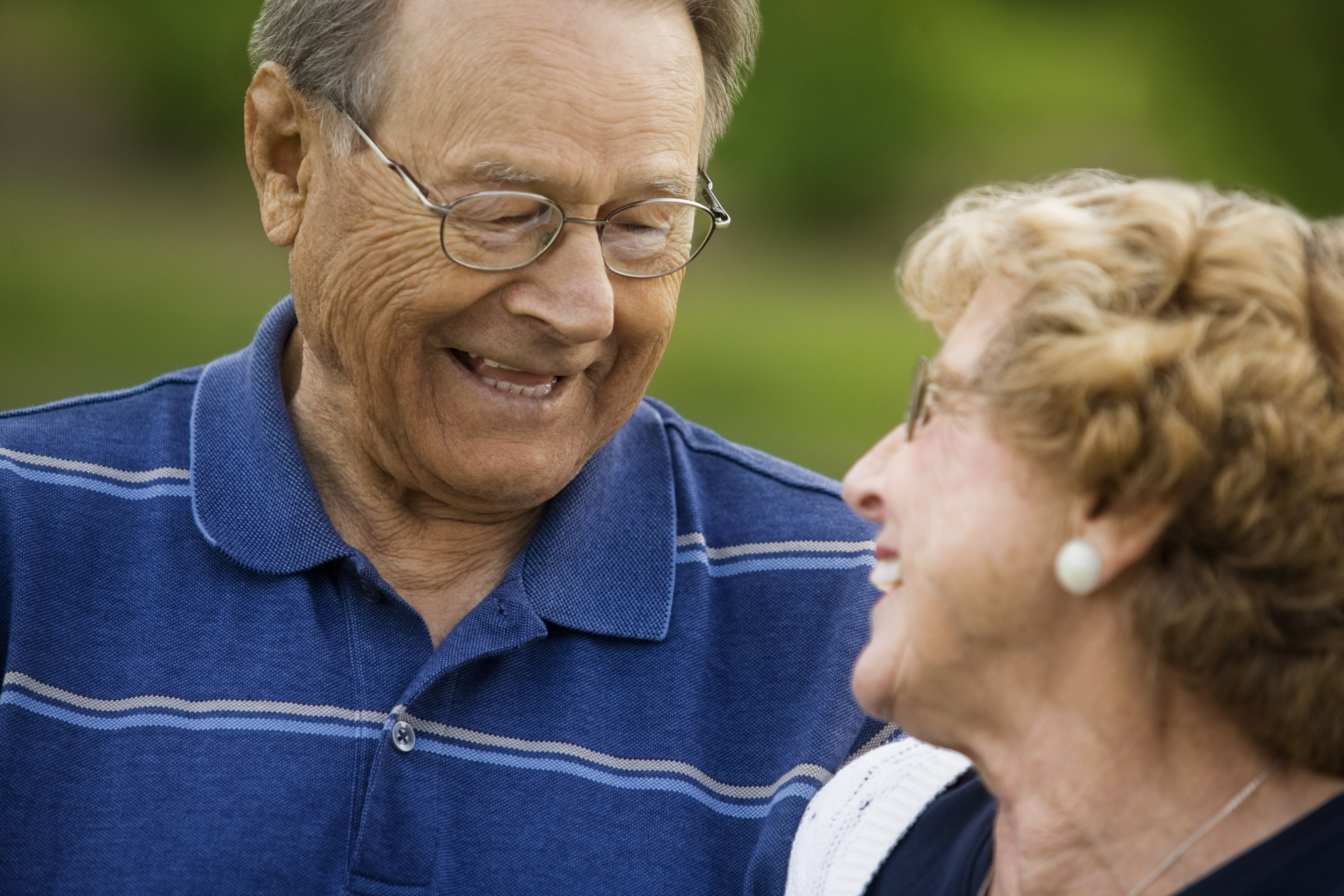Senior couple looking at each other while smiling